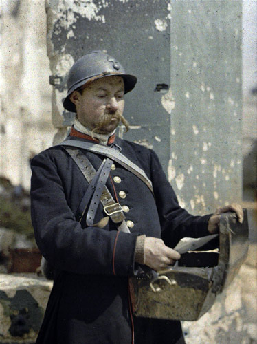 French military postman during Great War, in the city of Reims, 1917