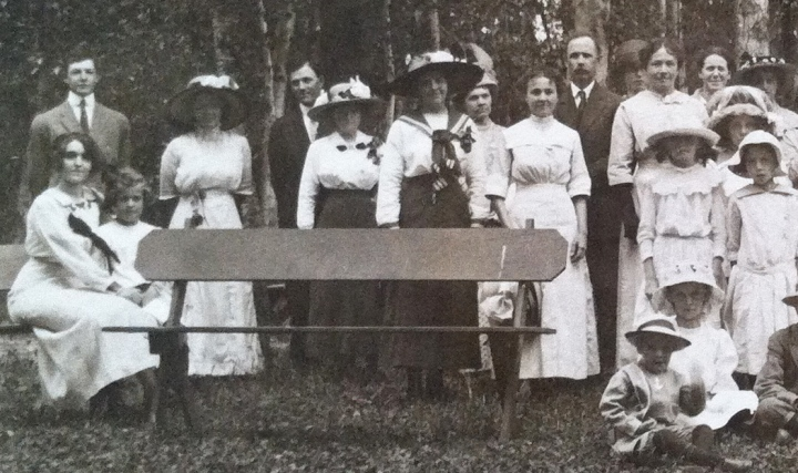 Left side of the photograph, with the near-empty bench in the foreground