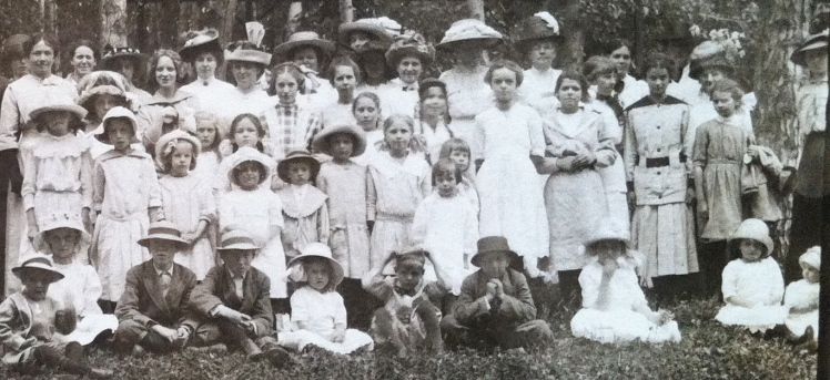 The children are in the center and on the right.