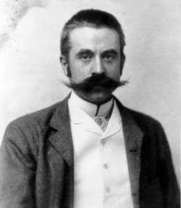 White's moustache may be described as impressive.