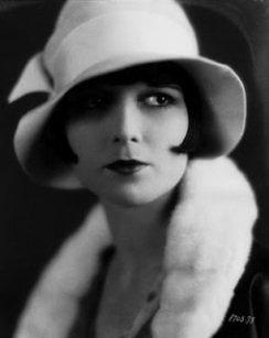 Actress Louise Brooks wearing a cloche hat
