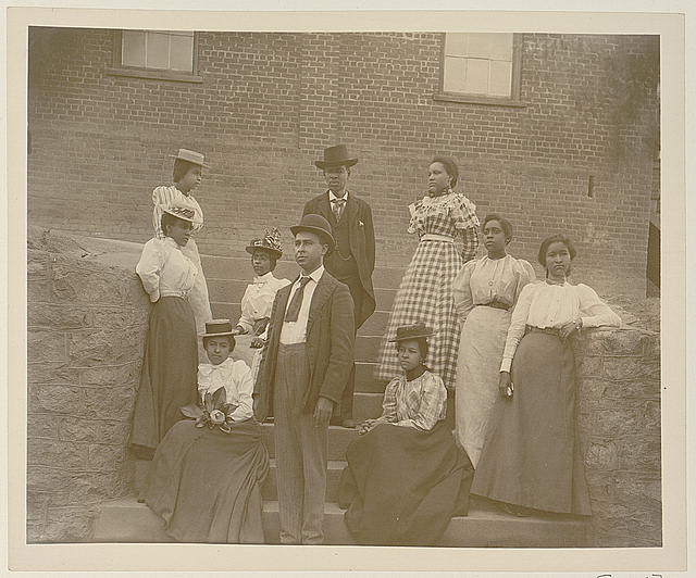 Group, dressed to the 9s, poses on steps, circa 1900 loc-govloc-pnpppmsca-08764