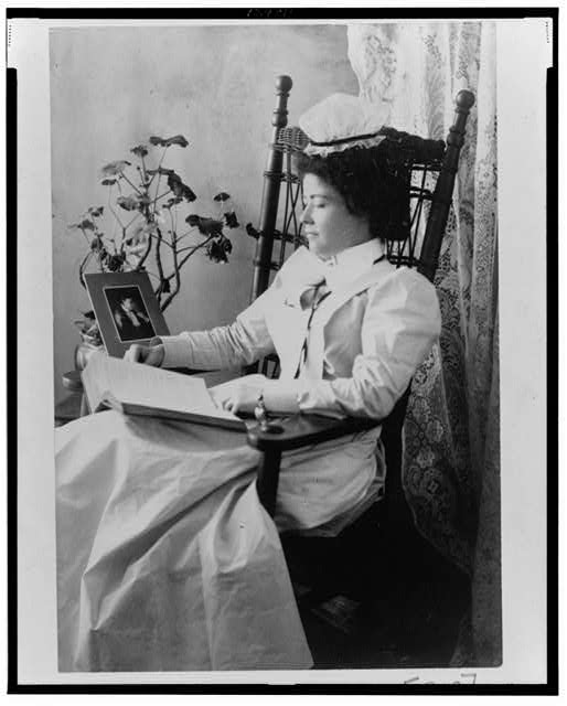 Nursing student wearing a starched white uniform, seated in a rocking chair, reading. 1900 Reproduction Number- LC-USZ62-124811