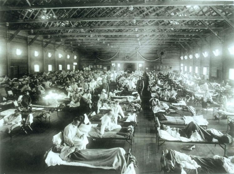 Soldiers from Fort Riley, Kansas, ill with Spanish influenza at a hospital ward at Camp Funston
